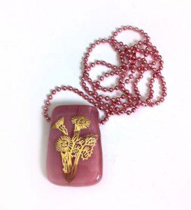 Thistle design in gold, on rose coloured glass slider pendant