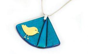 Happy Birdie design in gold, on teal dichroic glass fan pendant